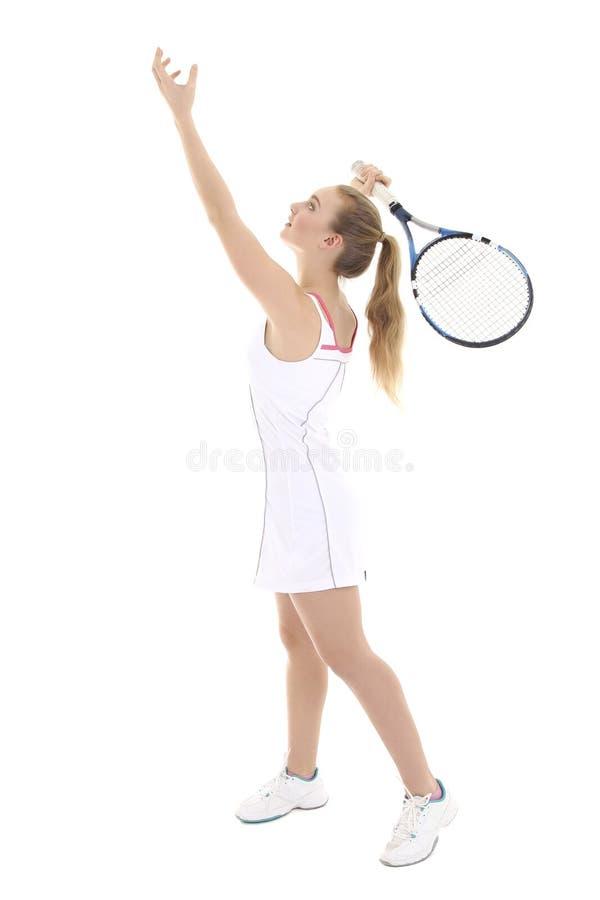 Молодой привлекательный женский теннисист с ракеткой над белизной стоковая фотография rf