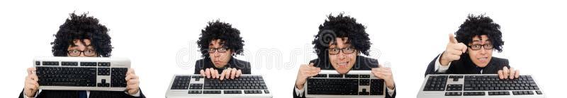 Молодой работник с клавиатурой изолированной на белизне стоковые фотографии rf
