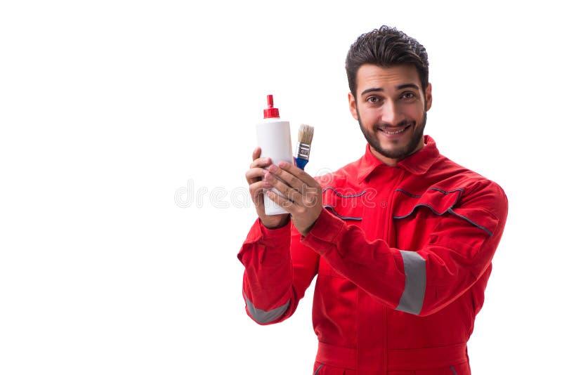 Молодой ремонтник с клеем краски и изолированная щетка paintbrush стоковые фотографии rf