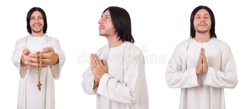 Молодой священник при библия изолированная на белизне стоковое изображение rf