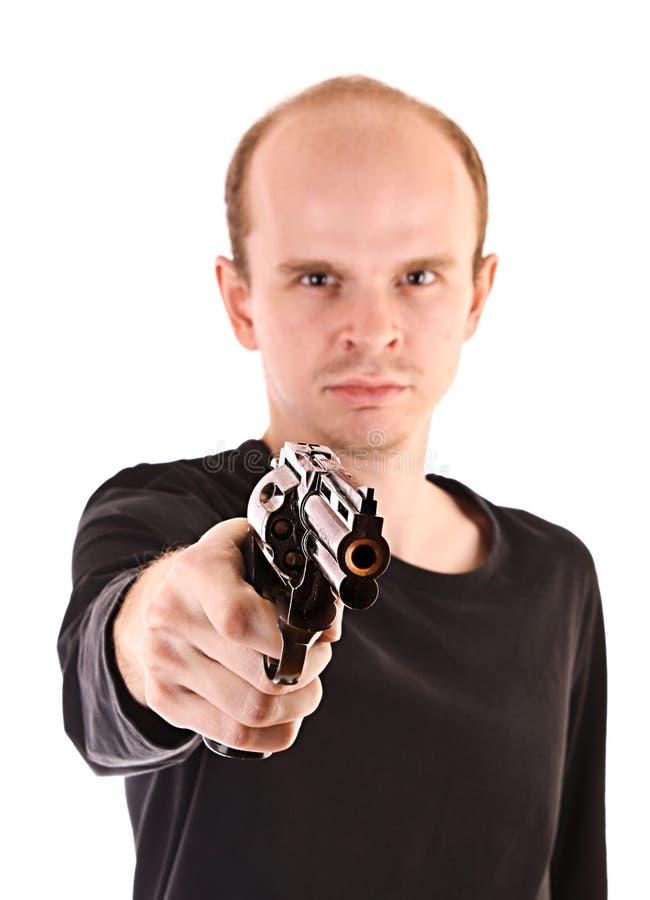 Молодой сердитый человек направляя с пушкой стоковая фотография rf