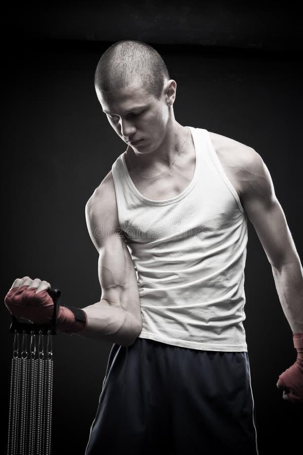 Молодой сильный человек стоковое фото