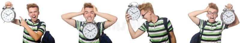 Молодой студент с будильником в концепции контроля времени стоковые изображения rf