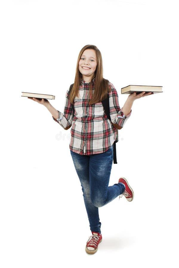 Молодой счастливый студент с сумкой и книгами школы стоковая фотография