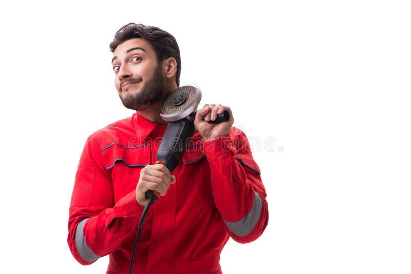 Молодой человек при круговой полировщик изолированный на белизне стоковая фотография rf