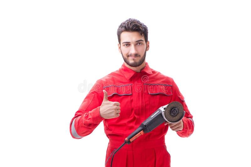 Молодой человек при круговой полировщик изолированный на белизне стоковые фотографии rf