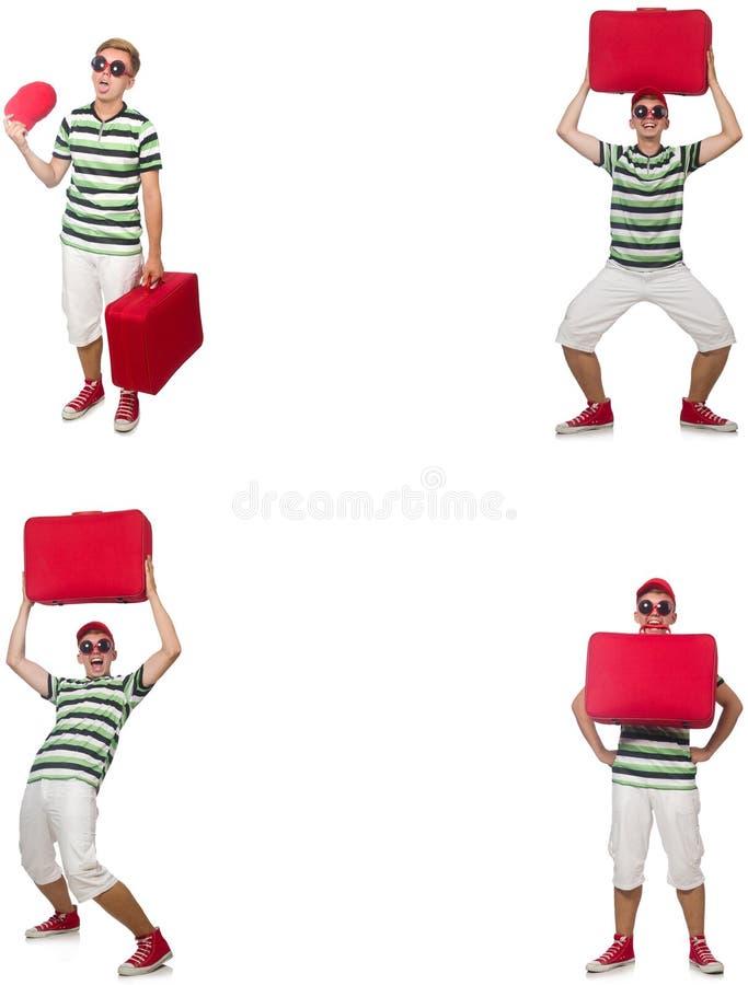 Молодой человек с красным чемоданом изолированным на белизне стоковая фотография rf