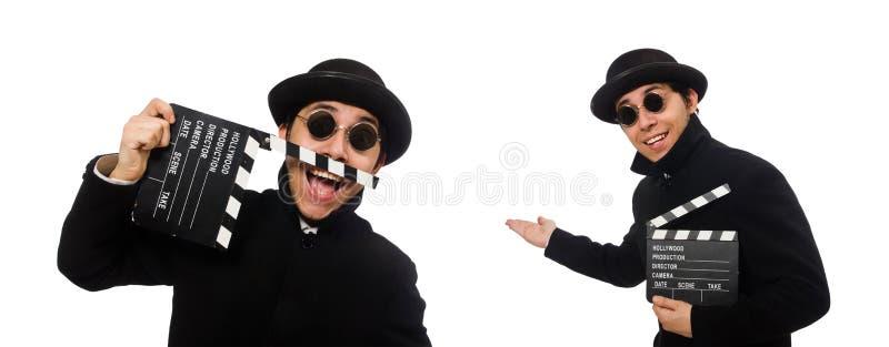 Молодой человек с нумератором с хлопушкой изолированным на белизне стоковое фото