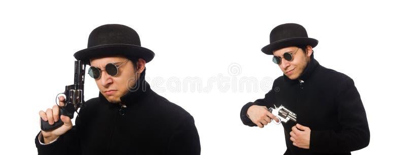 Молодой человек с оружием изолированным на белизне стоковые фото
