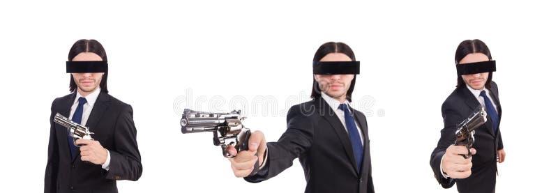 Молодой человек с покрытыми глазами и оружие изолированное на белизне стоковые изображения