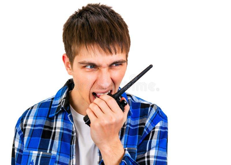 Молодой человек с портативным радио стоковые изображения rf