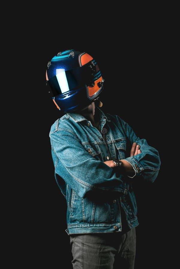 Молодой человек с участвовать в гонке шлем, hitman, тысячелетний стоковое фото rf