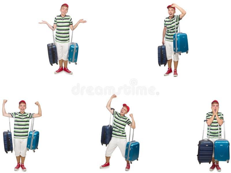 Молодой человек с чемоданом изолированным на белизне стоковая фотография