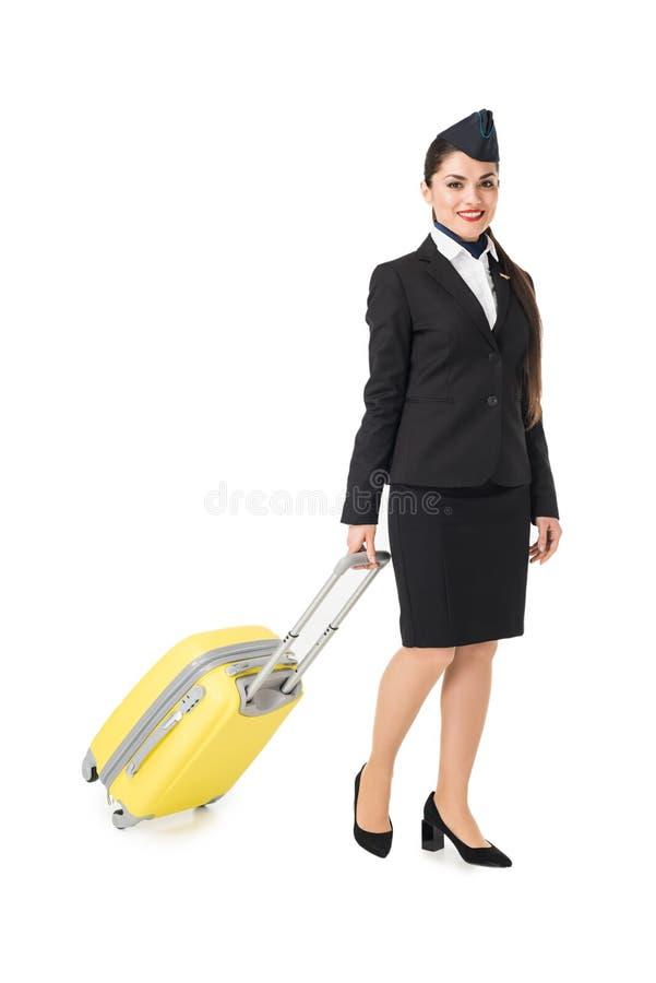 Молодой stewardess в чемодане удерживания формы стоковые фото