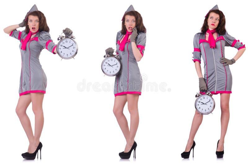 Молодой stewardess с будильником в концепции контроля времени стоковые фото