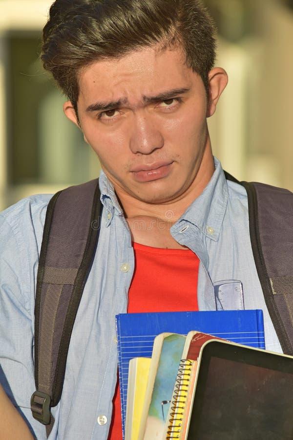 Моложавый филиппинский студент и запутанность стоковые изображения rf