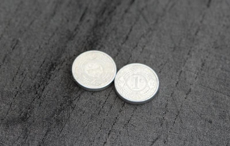 монетка гульдена Нидерланд цента 10 (10) Antillean на черной предпосылке стоковое фото