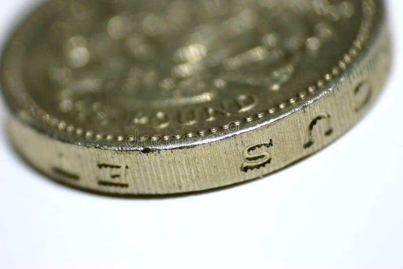 монетка один фунт стоковое фото rf