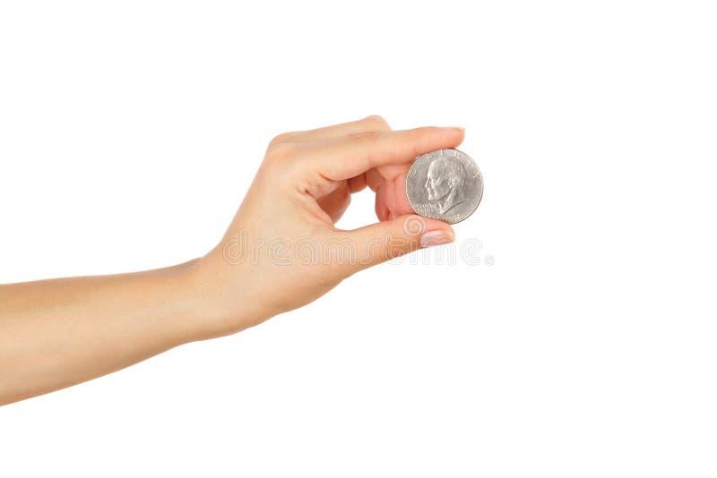 Монетка доллара в изолированной руке ` s женщины, стоковые изображения