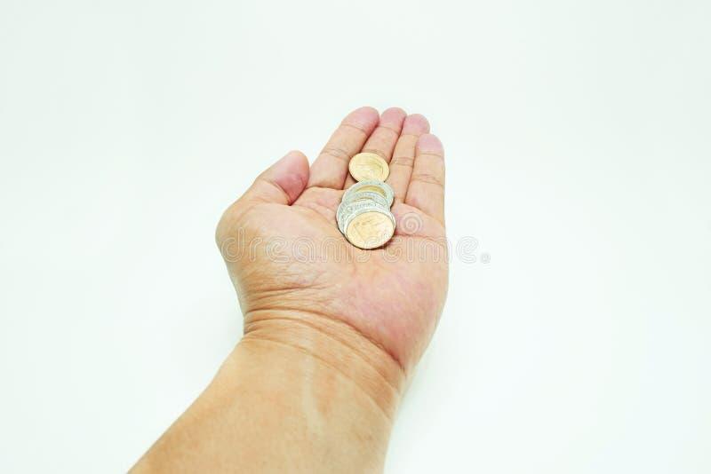 Монетки в руке стоковые фотографии rf