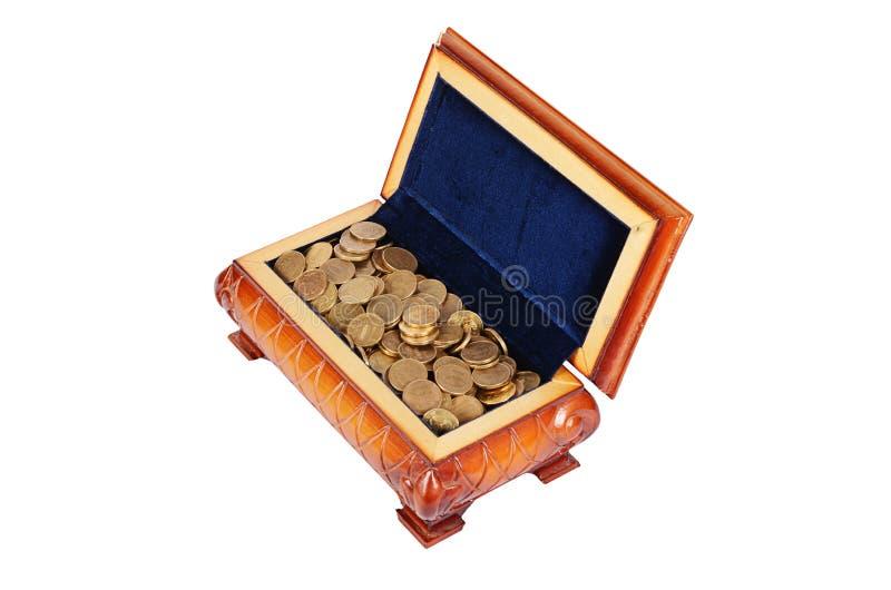 Монетки и банкноты в коробке стоковые фото
