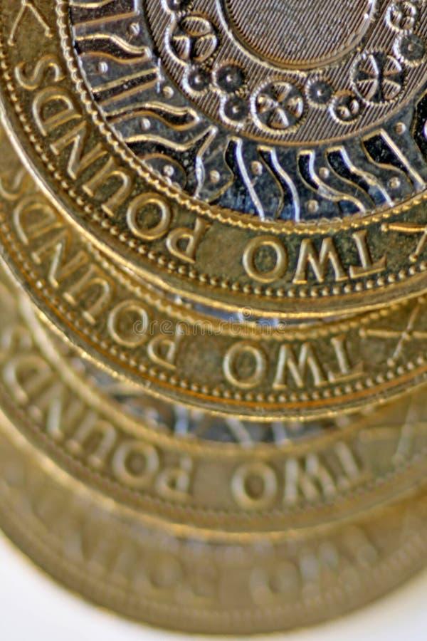 монетки колотят 2 стоковые изображения