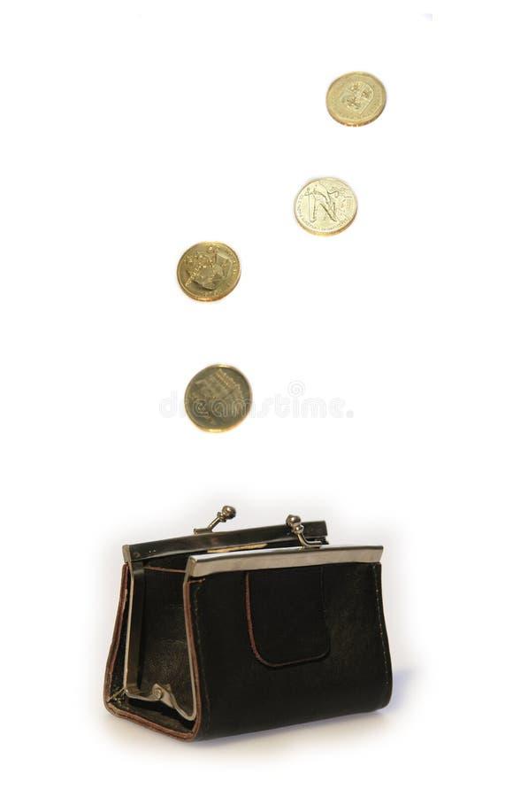 монетки летая портмоне стоковое фото
