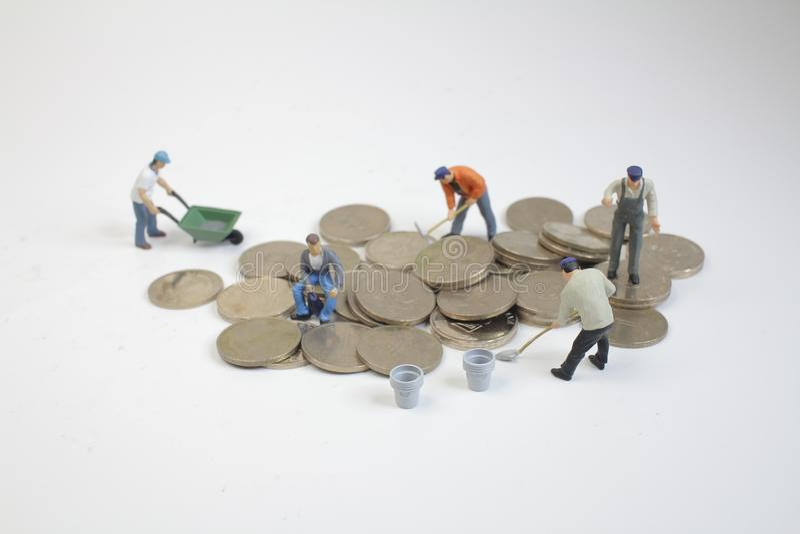 монетки мини движения работников растущие деньги стоковая фотография rf