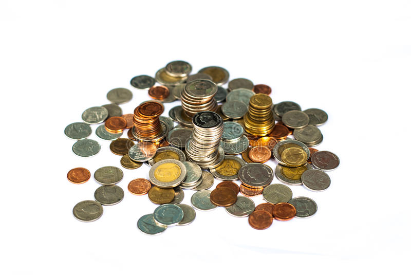 монетки наличных дег предпосылки изолировали белизну дег стоковая фотография rf