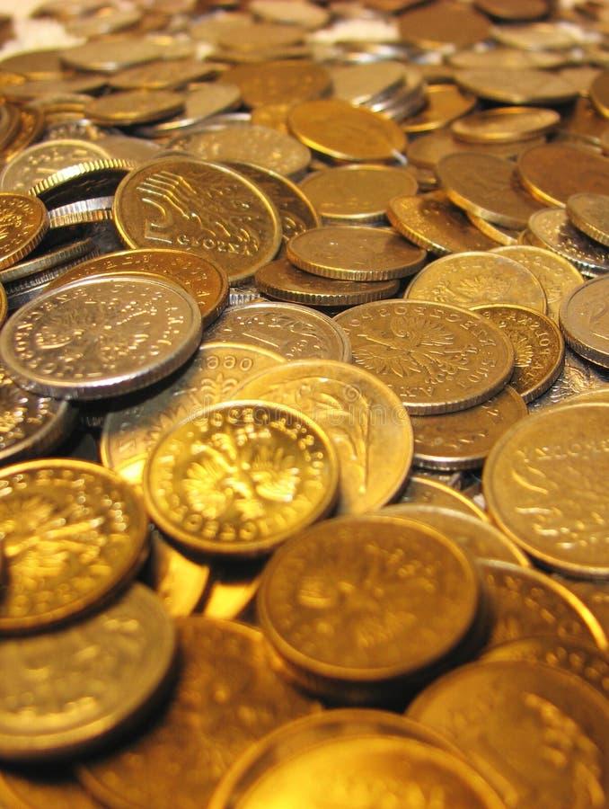 монетки предпосылки стоковая фотография