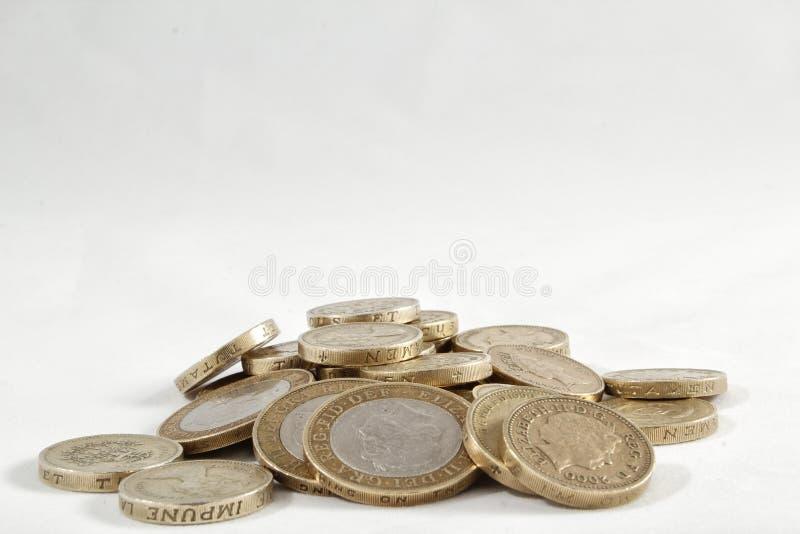 Монетки фунта Великобритании стоковая фотография