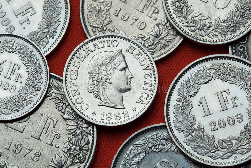 Монетки Швейцарии Голова Libertas стоковые изображения