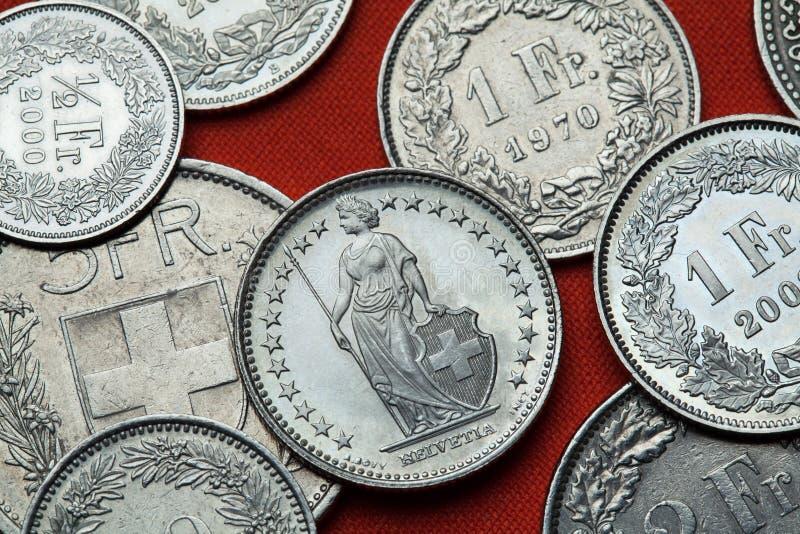 Монетки Швейцарии Стоя Helvetia стоковые фото