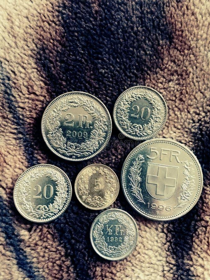 Монетки Швейцарии Швейцарский франк стоковые изображения