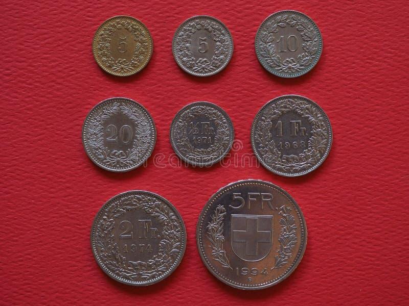 Монетки швейцарского франка, Швейцария стоковые изображения
