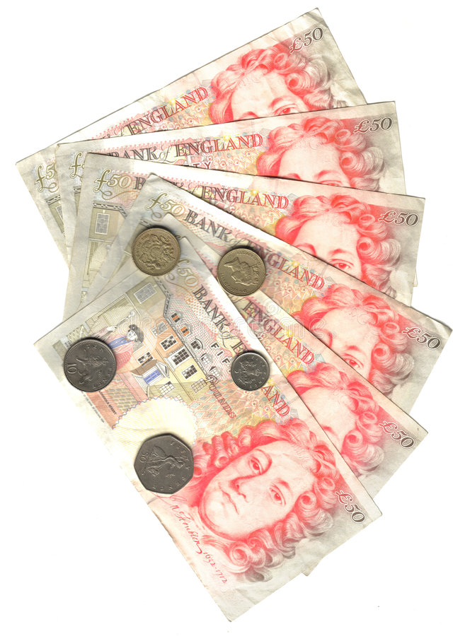 монетки 50 фунтов ряда стоковая фотография rf