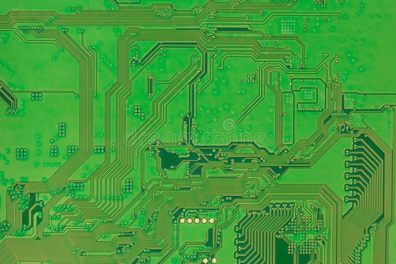 Монтажная плата, современный крупный план предпосылки зеленого цвета задней стороны электроники стоковые изображения