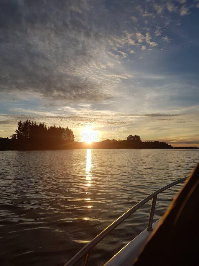 Море захода солнца заволакивает inshoore стоковые изображения rf