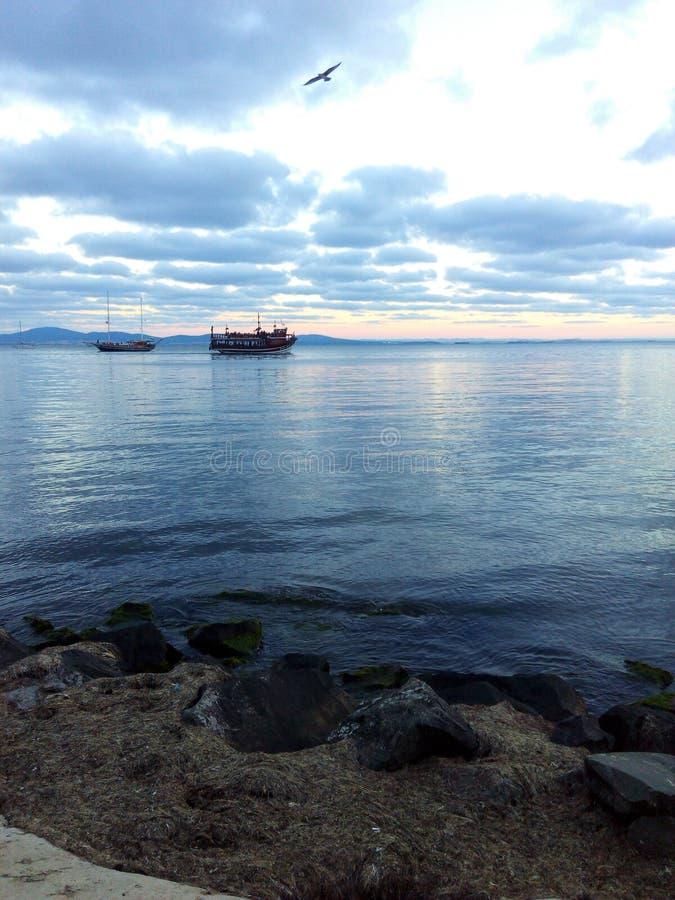 море ландшафта Греции дня шлюпки солнечное стоковое изображение rf