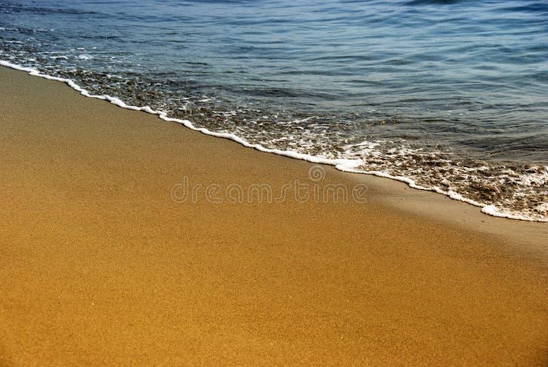 море песка золота пены стоковое фото rf