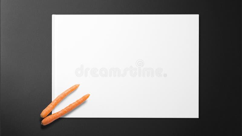 Моркови младенца на белой бумаге на черной предпосылке стоковые фотографии rf