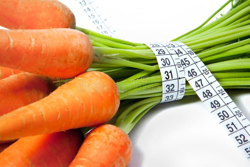 Моркови с рулеткой стоковые фотографии rf