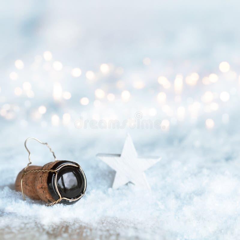 Мотив рождества с пробочкой шампанского стоковые изображения