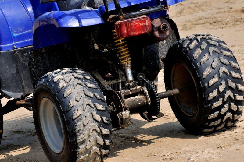 Мотоцикл на песке пляжа Стоковое Изображение RF