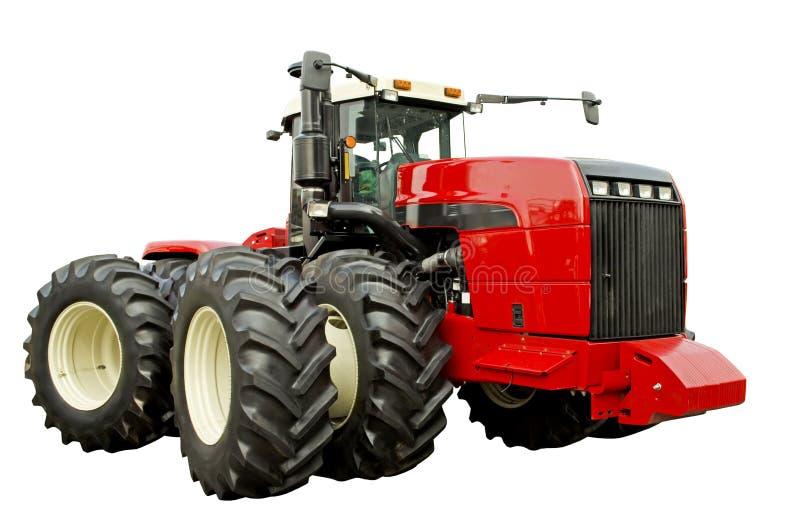 Мощный аграрный трактор стоковые изображения rf