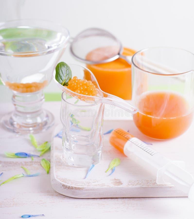 Молекулярный варить икры манго-моркови стоковое изображение rf