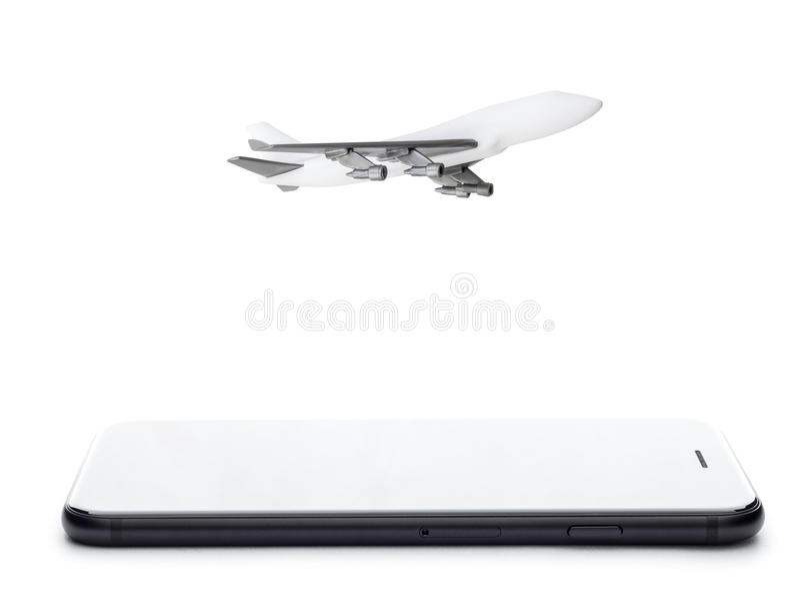 Модель телефона и самолета на белизне стоковые фотографии rf