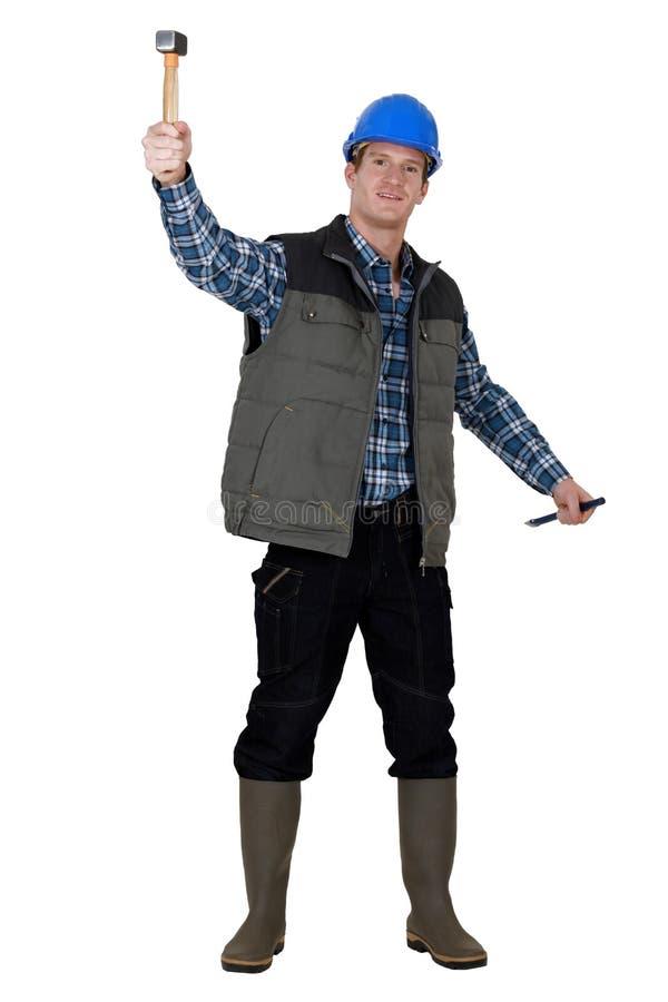 Молоток лейбориста поднимаясь стоковая фотография