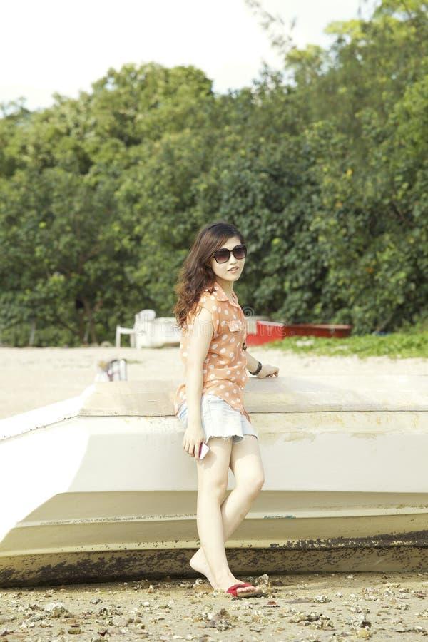 Молодая азиатская женщина в лете стоковое изображение rf