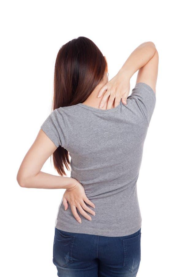Молодая азиатская женщина получила боль в спине стоковая фотография rf